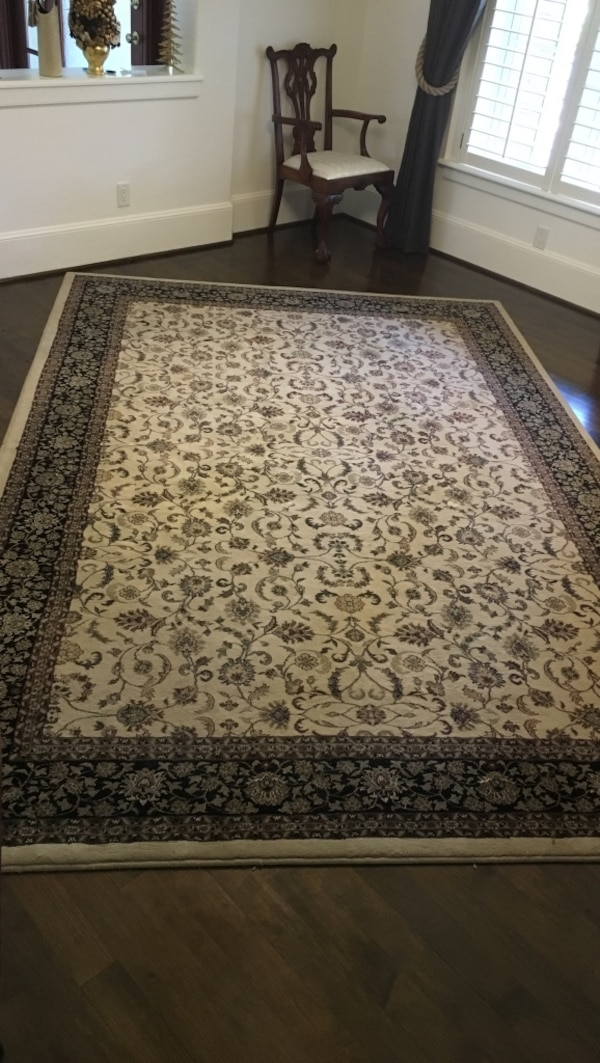 Cream and brown / black floral area rug