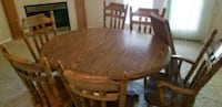 oval brown wooden dining table with chairs set Nampa, 83686
