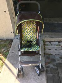 yellow gray and brown umbrella stroller