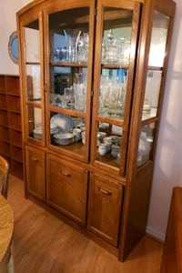 brown wooden china cabinet with glass display cabi