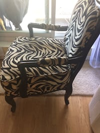Colonial style arm chair, Zebra Black/Tan,colonial style arm chair with solid wood frame  pillow can move and wash, measures 28 inch  wide at the arms,,clean, smoke free . bought at Winners store. Kitchener