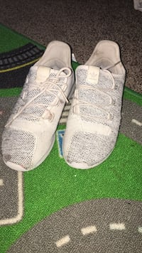 Pair of white adidas low top sneakers Sioux Falls, 57110