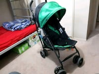 baby's green and black stroller Calgary
