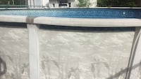 White and blue above ground pool with accessories stairs and motor in good condition  Laval, H7W 4L9