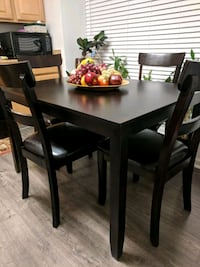 rectangular brown wooden table with four chairs dining set Fairfax, 22033