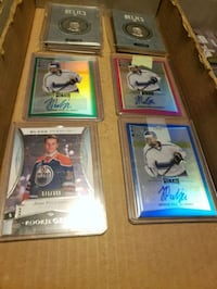 four assorted-color baseball trading cards Edmonton, T6T 0L5