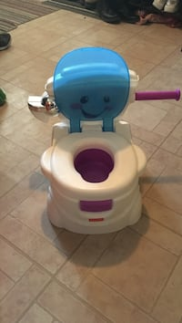 Toddler's white and blue fisher-price potty trainer Montréal, H1W