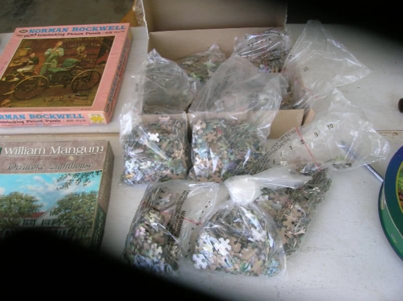 Three (3) Boxes of Multiple Piece Puzzles a52b9432-0dc5-48b9-aff3-75ab93dce2a6