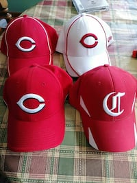 three red and one white Champion fitted caps