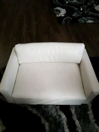 white fabric sofa chair with ottoman