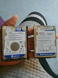 two Western Digital WD Blue and Scorpio Blu hard disk drives
