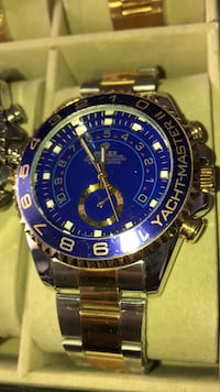 round blue Rolex chronograph watch with link bracelet Brampton, L6T
