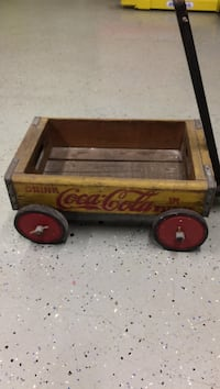 yellow and brown Coca-Cola wooden pull wagon