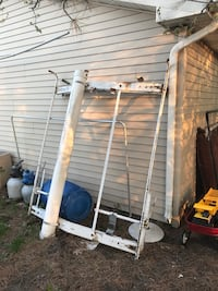 White universal van ladder rack will hold any ladder without any bungees or ratchet straps! Will fit on any van or truck with the gutter rails along the sides, one clamp is broken but could be easily fixed. Come get it, price cannot be beat! Mason, 48854