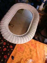wicker mirror around 3 feet. really nice. very well built