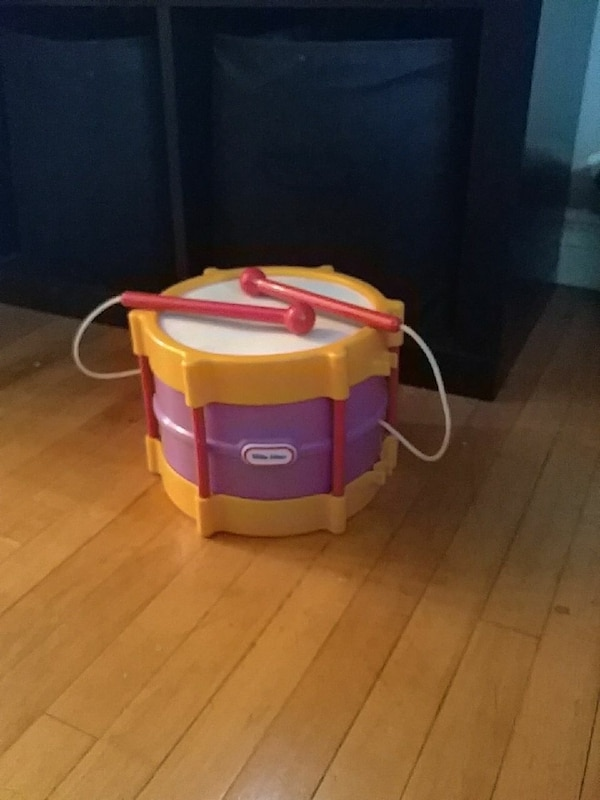 purple and brown Little Tikes snare drum