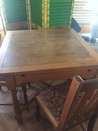 Brown wooden table with chairs Riviera Beach, 33404