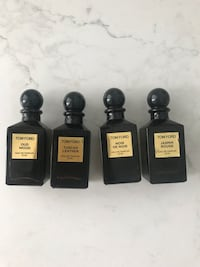 four Tom Ford fragrance bottles