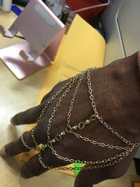 Gold hand and wrist chain with diamonds down the middle! Oakland, 94621