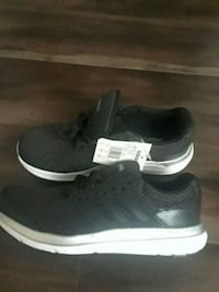 Ladies Adidas running shoes size 9. Brand new