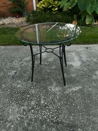round black metal framed glass top table Stone Mountain, 30087