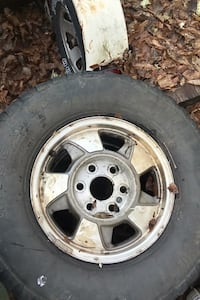 """Set of 4 tock Chevy aluminum 16"""" wheels and tires"""