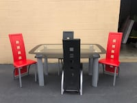 Glass Top Kitchen Table With 2 Black and 2 Red Kitchen Chairs Woodbridge, 22192