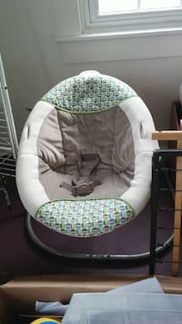 baby's green, brown and white bouncer