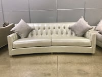 2 BRAND NRW COUCHES WITH PILLOWS BOUGHT FROM ELDORADO Silver 2 couches for 2,200. 94x40x34.  Leatherette Cape Coral, 33904