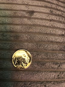 Round gold-colored coin