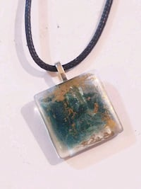 Abstract green and brown glass pendant on corded n Lubbock, 79414