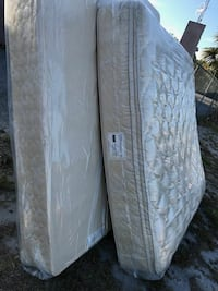 two quilted white mattresses