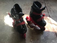 Pair of black-and-red inline skates 28 km