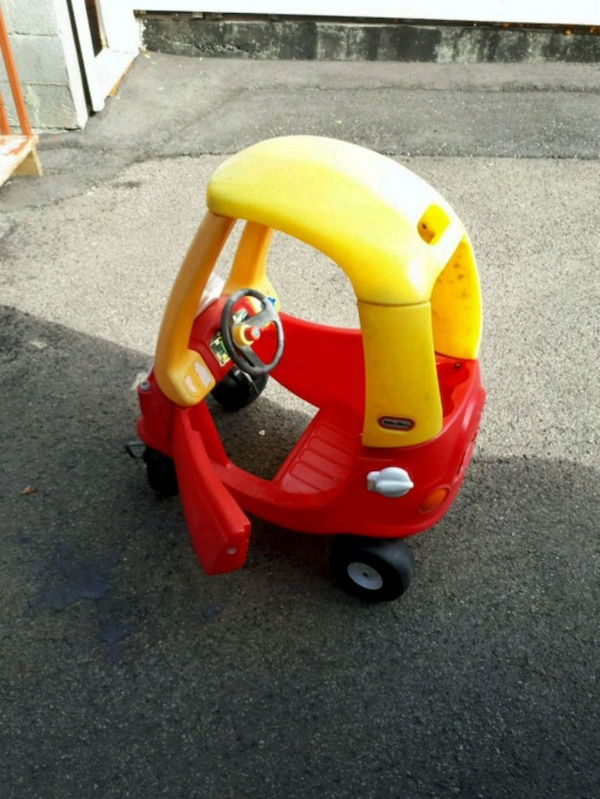 yellow and red Little Tikes Cozy Coupe 3603f61d-bf61-449f-8881-e457b517bdec