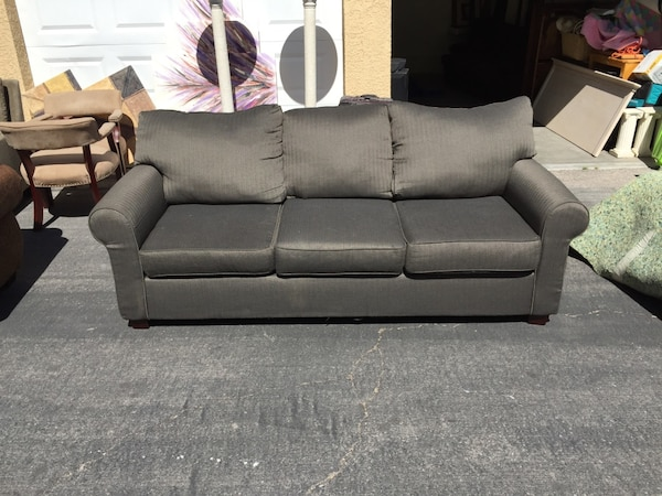 black 3-seat couch 24a11485-5ad1-4a4b-b8bf-e0d1af58b2a5