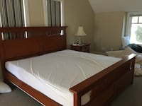 brown wooden bed frame with white mattress Calgary, T2N 1C5