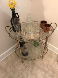 Oval brass framed clear glass 2 layer table
