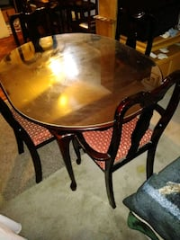 round brown wooden table with four chairs dining set Las Vegas, 89104