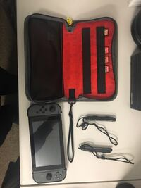 Mint Condition Nintendo Switch with Games and Accessories Manassas, 20109