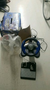 black and blue steering wheel game controller Toronto, M9W 1W1