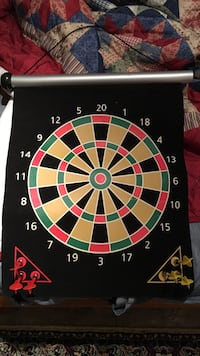 Red, green,and brown dartboard with dart pins Waldorf
