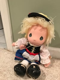 doll wearing white and black dress