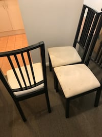 two black wooden framed white padded chairs Surry Hills, 2010