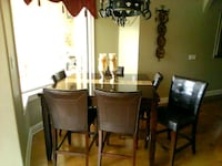 rectangular brown wooden table with six chairs dining set Lake Mary, 32746
