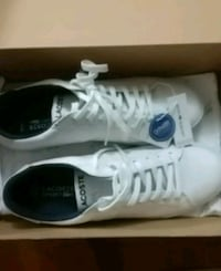 pair white Lacoste shoes