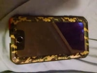 black iPhone 6swith brown, yellow, and green camou