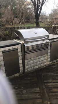 Outdoor kitchen with grill, fridge, sink, and burner Alexandria, 22312
