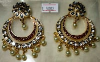 pair of gold and silver earrings Baltimore, 21207