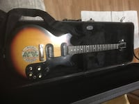 brown and black electric guitar in case Ketchum, 83340