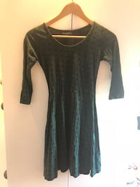 Green dress with black spots